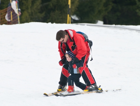 Ben Moore, co-founder of family site paralleltrails.co.uk, skiing with one of his sons