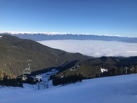 Bansko swathed in cloud, but the sun is shining on the upper slopes