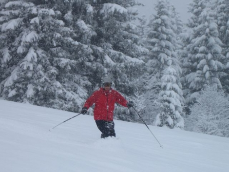 Stanford Skiing owner John Kinnear cruising through knee-deep powder on Rochebrune on Saturday morning