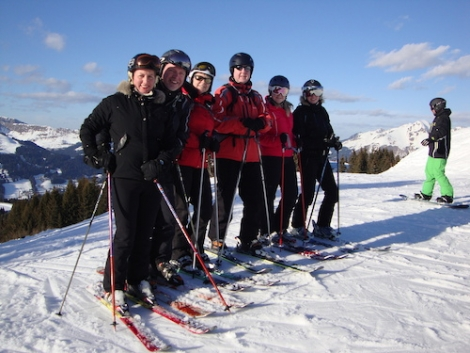 Last year's report winner, Barry Patrick (4th from left) last week on his prize ski holiday