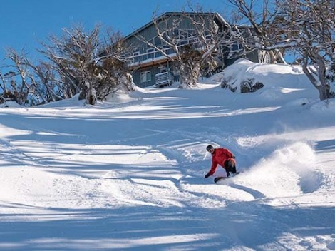 A skier enjoys the fresh powder yesterday in Perisher, New South Wales